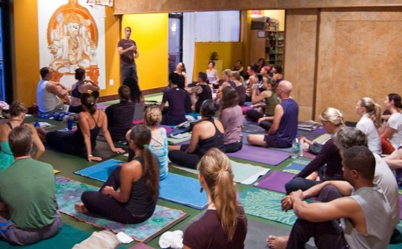 Photo: crowded room at a yoga