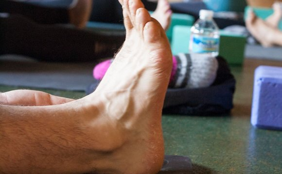 Photo: a foot on a yoga mat