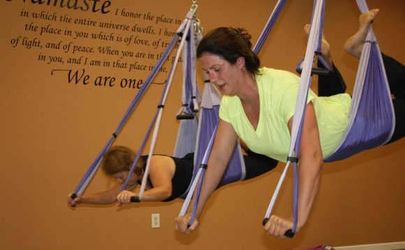 Yoga swing classes aids