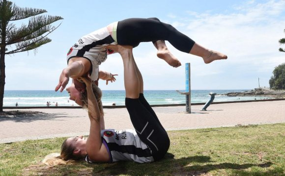 In an acroyoga pose