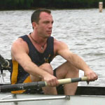 Dr. Joseph Henderson, rowing on a lake
