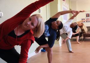 Photo image of Women Veterans participating in the West Palm Beach VA Yoga Group for Women Veterans.