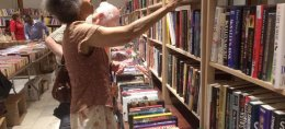 Shoppers browse through six rooms of The Newberry on Thursday during the 32nd annual book fair.