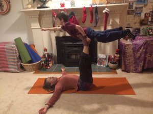 superman partner yoga pose